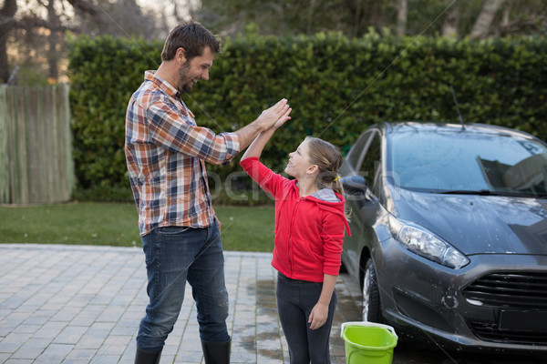 Young girl and father giving high five to each other Stock photo © wavebreak_media