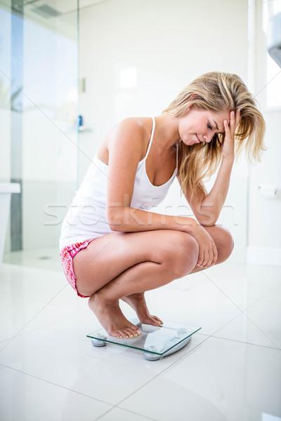 Szomorú szőke nő mérleg fürdőszoba nő otthon Stock fotó © wavebreak_media