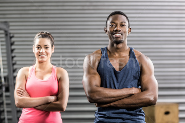 Stock photo: Fit couple with arm crossed