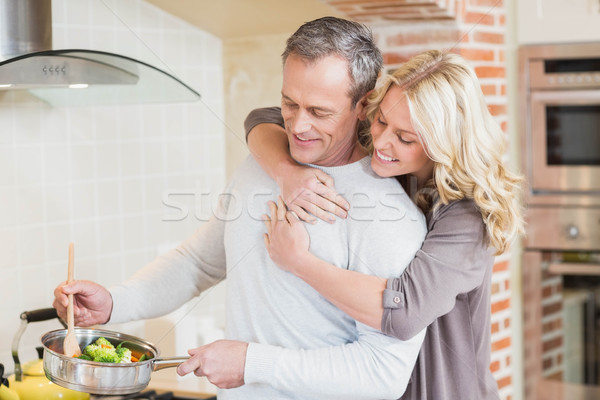Cute пару приготовления кухне женщину продовольствие Сток-фото © wavebreak_media