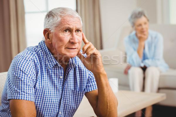 Worried senior man sitting on sofa Stock photo © wavebreak_media