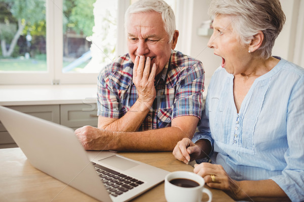 Surprised senior couple using laptop Stock photo © wavebreak_media