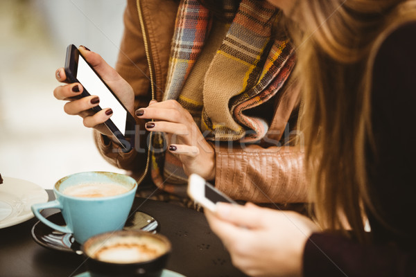 Friends looking at smartphone Stock photo © wavebreak_media