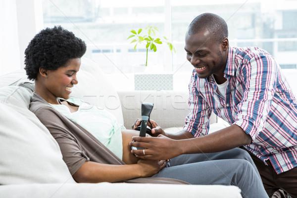男 ヘッドホン 妊娠 胃 リビングルーム ストックフォト © wavebreak_media