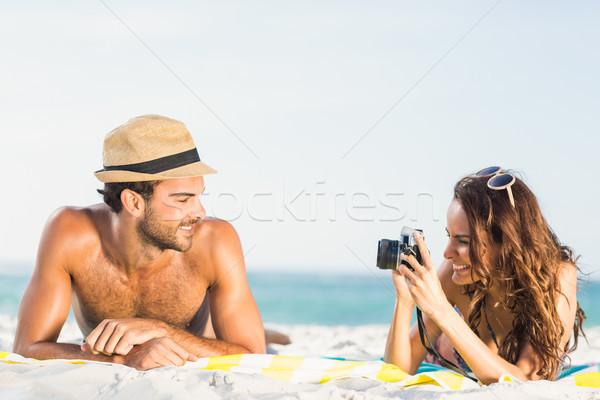 Girlfriend taking picture of boyfriend Stock photo © wavebreak_media