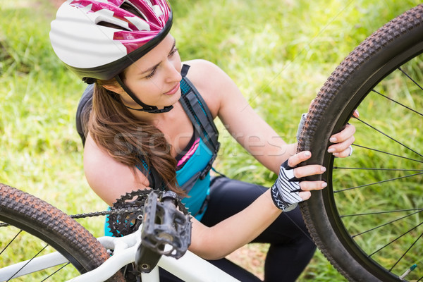 Woman fixing her bike Stock photo © wavebreak_media