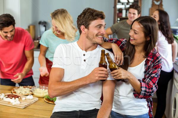 Feliz cerveza botellas casa Foto stock © wavebreak_media