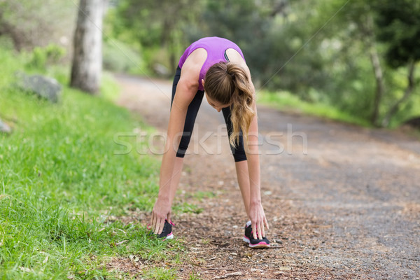 Young woman exercising on footpath Stock photo © wavebreak_media