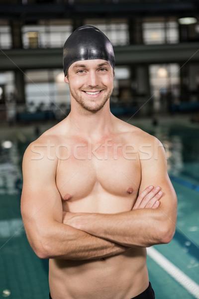 Portrait of happy swimmer standing by the pool Stock photo © wavebreak_media