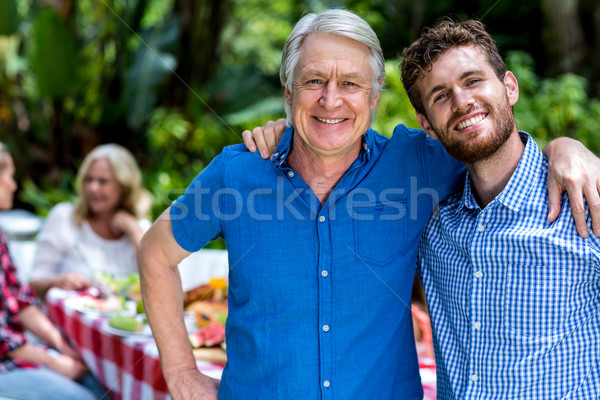 Happy father and son standing in yard  Stock photo © wavebreak_media