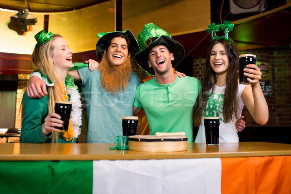 Smiling friends with Irish accessory Stock photo © wavebreak_media