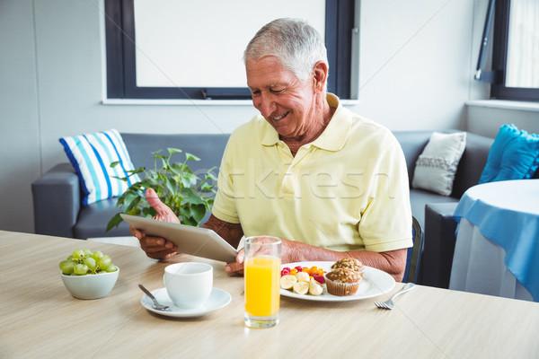 Senior man using a digital tablet Stock photo © wavebreak_media