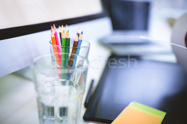 Desk organizer with drinking glass and graphics tablet  Stock photo © wavebreak_media
