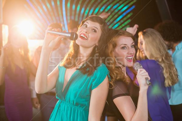 Two beautiful women singing song together Stock photo © wavebreak_media
