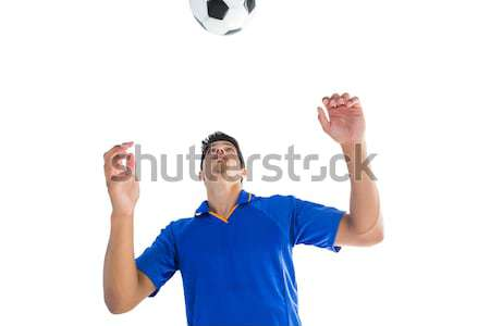 Man in blue shirt with arms raised Stock photo © wavebreak_media