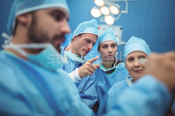Team of surgeons having discussion in operation theater Stock photo © wavebreak_media
