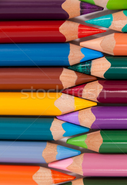 Colored pencils arranged in interlock pattern Stock photo © wavebreak_media