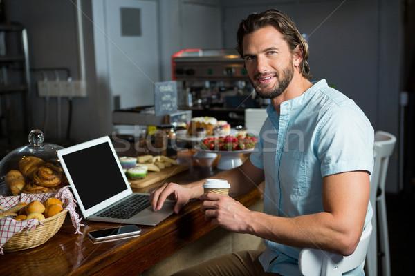 улыбаясь человека кофе используя ноутбук борьбе портрет Сток-фото © wavebreak_media