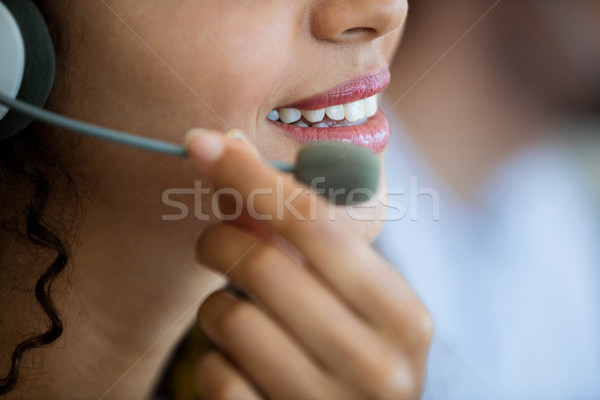 Customer service executive adjusting her mic Stock photo © wavebreak_media