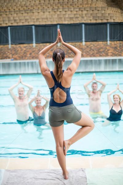 женщины йога тренер старший женщину воды Сток-фото © wavebreak_media