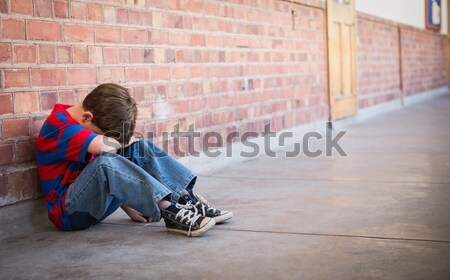 Stock photo: Upset lonely girl sitting by herself