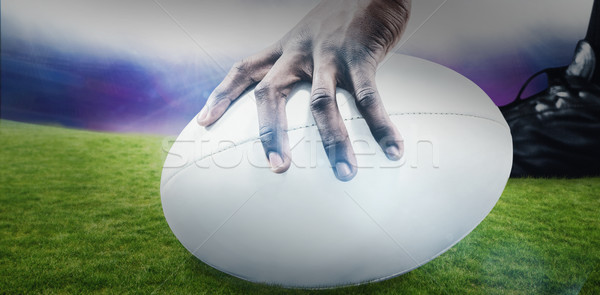 Composite image of cropped image of sportsman holding rugby ball Stock photo © wavebreak_media