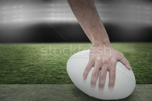 Composite image of close-up of sports player holding ball Stock photo © wavebreak_media