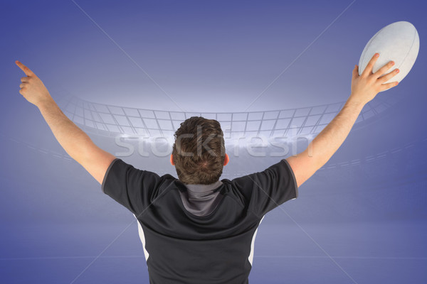 Composite image of back turned rugby player gesturing victory Stock photo © wavebreak_media
