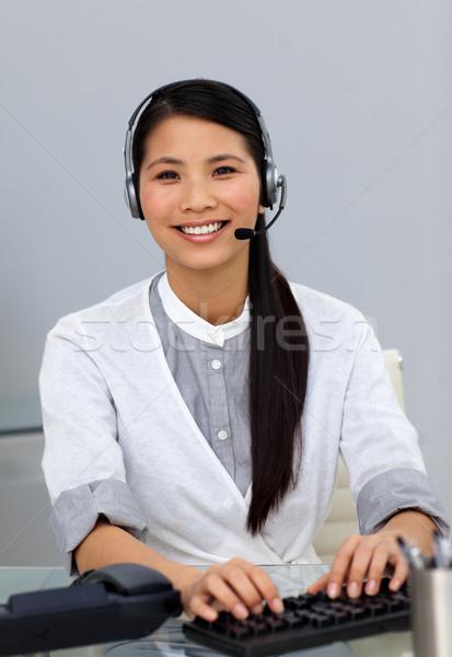 Etnica servizio di assistenza rappresentante auricolare sorridere fotocamera Foto d'archivio © wavebreak_media