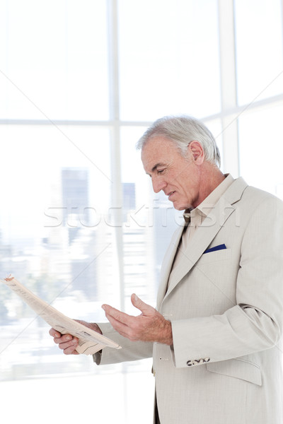 Portrait of a senior manager reading newspaper Stock photo © wavebreak_media