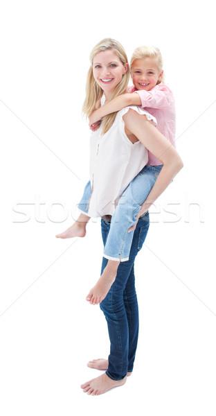Adorable petite fille ferroutage mère blanche Photo stock © wavebreak_media