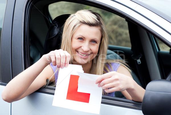 Derűs fiatal női sofőr felfelé felirat Stock fotó © wavebreak_media