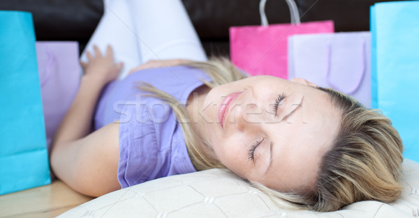Stock photo: Charming woman after shopping sleeping on the floor