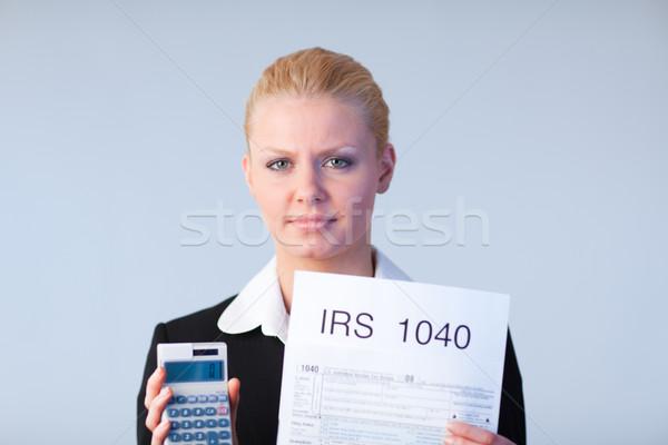 Füllung Steuer business woman schauen Computer Papier Stock foto © wavebreak_media