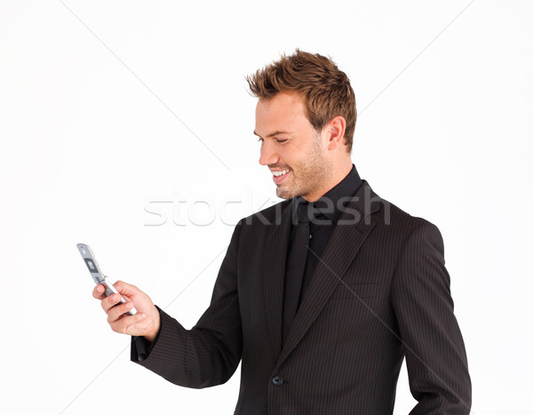 Smiling businessman writing a message with a mobile phone Stock photo © wavebreak_media