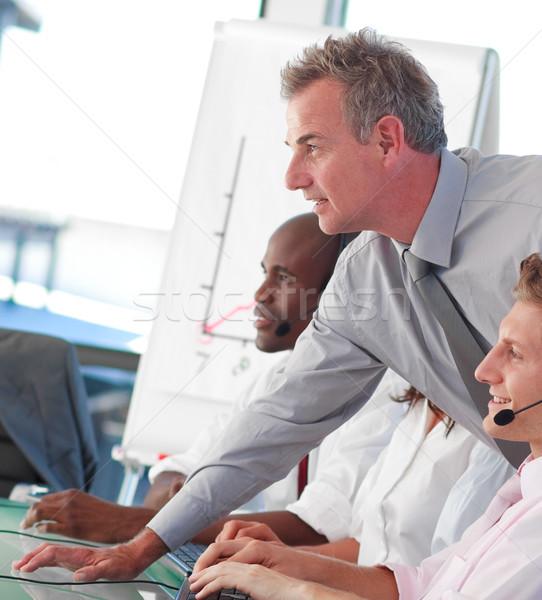 Zakenlieden werken call center internationale bedrijfsleven mensen die computer Stockfoto © wavebreak_media