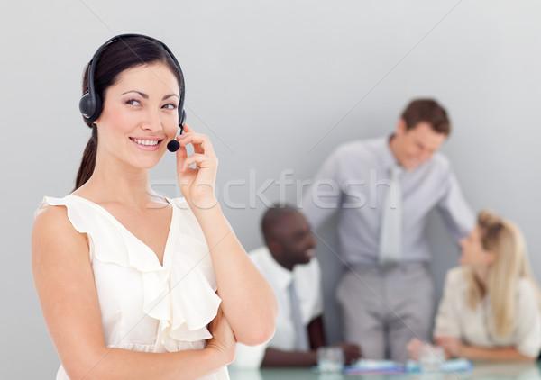 Attractive businesswoman talking on a headset Stock photo © wavebreak_media