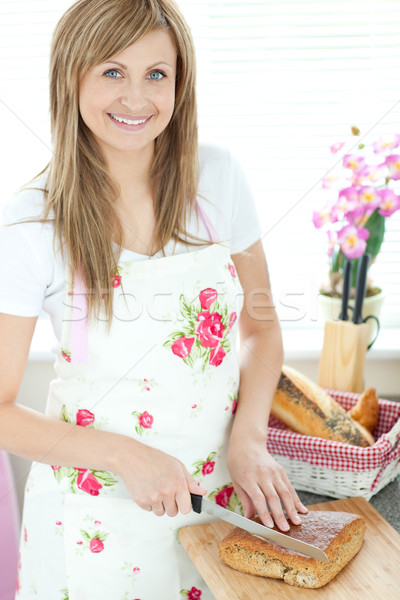 Radiant woman cutting bread in the kitchen  Stock photo © wavebreak_media