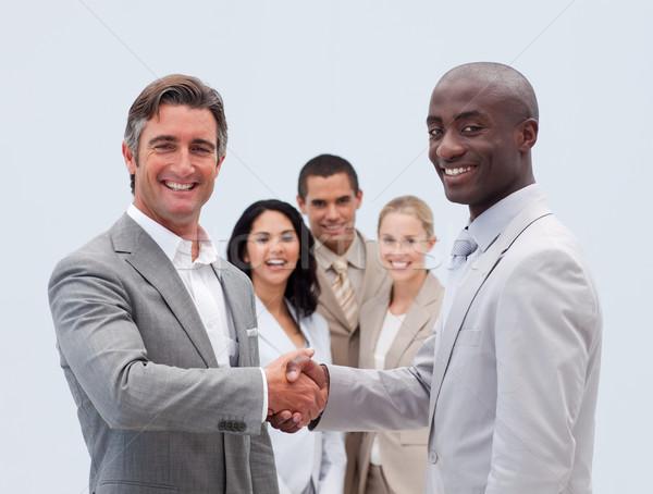 Caucásico empresarios apretón de manos colegas negocios mujer Foto stock © wavebreak_media