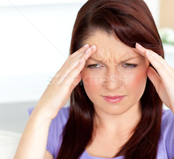 Nő fejfájás ül nappali otthon kezek Stock fotó © wavebreak_media