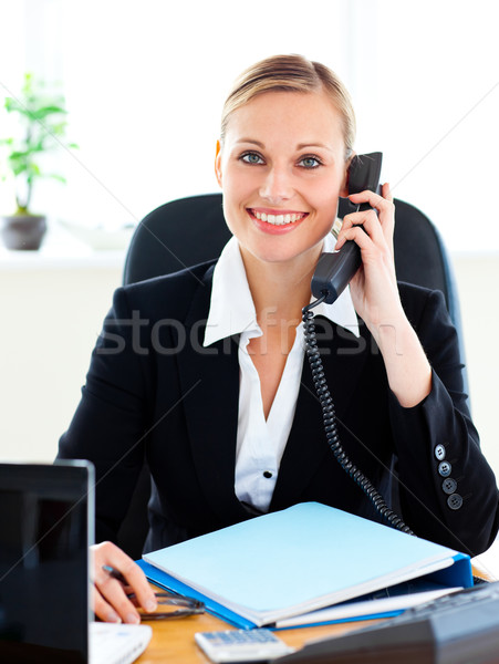 Radiant businesswoman talking on phone in her office at her desk Stock photo © wavebreak_media