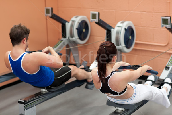Concentrated people using a rower in a fitness center Stock photo © wavebreak_media