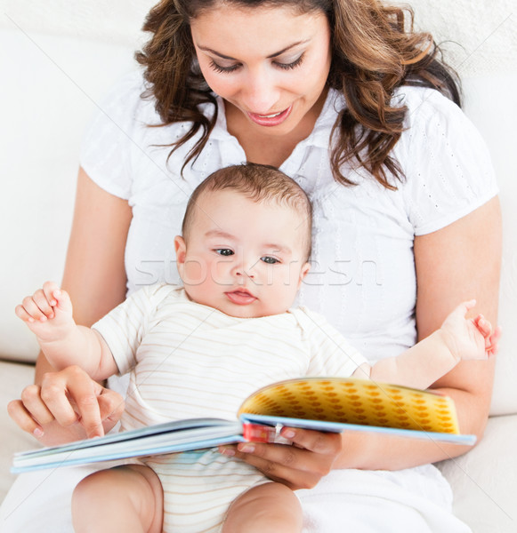 Bright mother showing images in a book to her cute little son at home Stock photo © wavebreak_media