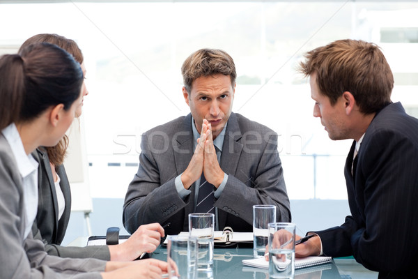 Serious manager talking to his team during a meeting in the office Stock photo © wavebreak_media