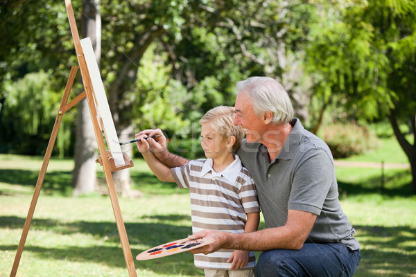 Happy Grandfather and his grandson painting in the garden Stock photo © wavebreak_media