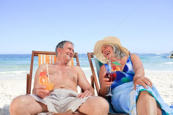Seduta deck sedie acqua uomo Foto d'archivio © wavebreak_media