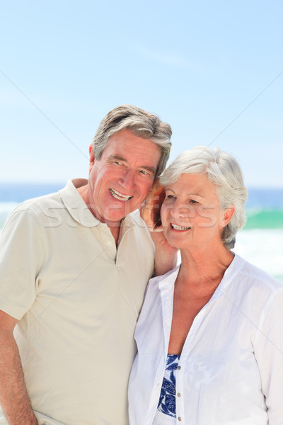 Retired couple listening to their shell Stock photo © wavebreak_media