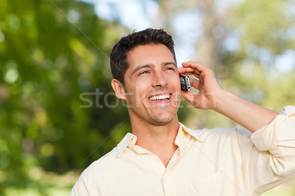 Man phoning in the park Stock photo © wavebreak_media
