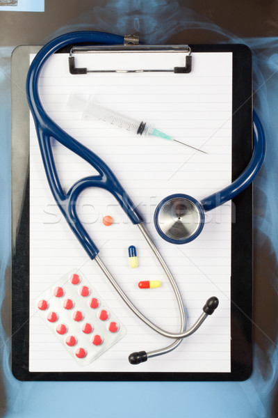 Note pad and blister strip with medicine and blue stethoscope Stock photo © wavebreak_media