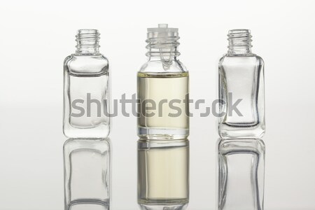 Glass flasks and pink petals with a camera focus on the flasks Stock photo © wavebreak_media